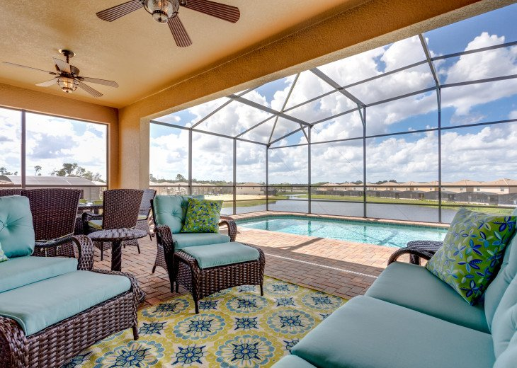 Relax under the lanai and enjoy the views over the pool to the lake beyond