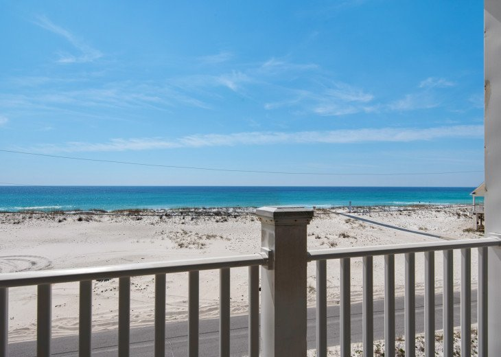 Relax and enjoy watching your kids at the beach from our front porch