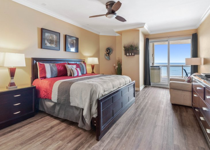 Master Bedroom with King Bed and oceanfront balcony entrance