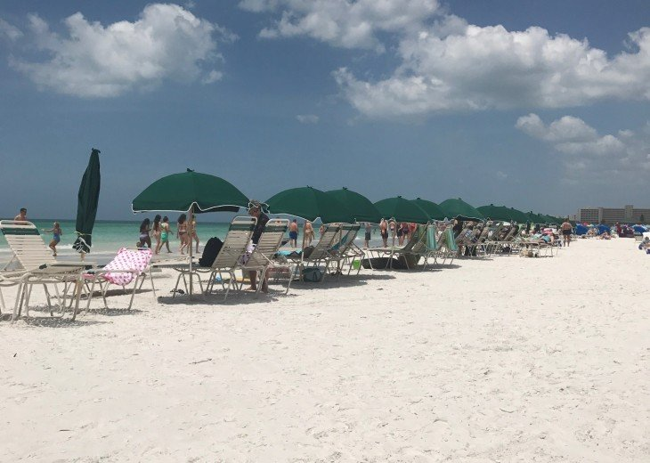 Our Private Beach with chairs and umbrellas