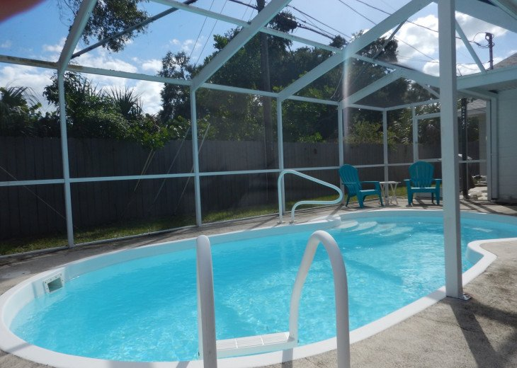 Caged saltwater (not chlorine) pool with jets.