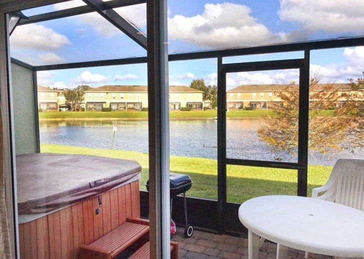 Screened patio with private hot tub and lake view.