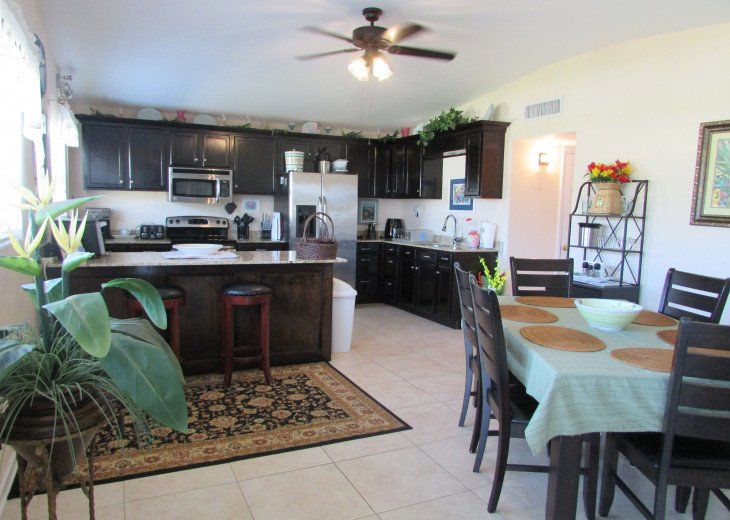 Large kitchen with granite counter tops, seating for 6.
