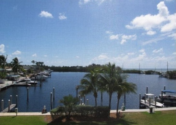 Luxury 3 bedroom condo overlooking harbor with ocean view, boat slip, amenities #1