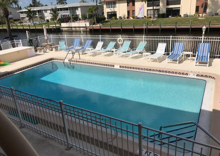 Large heated swimming pool overlooking wide gulf access canal