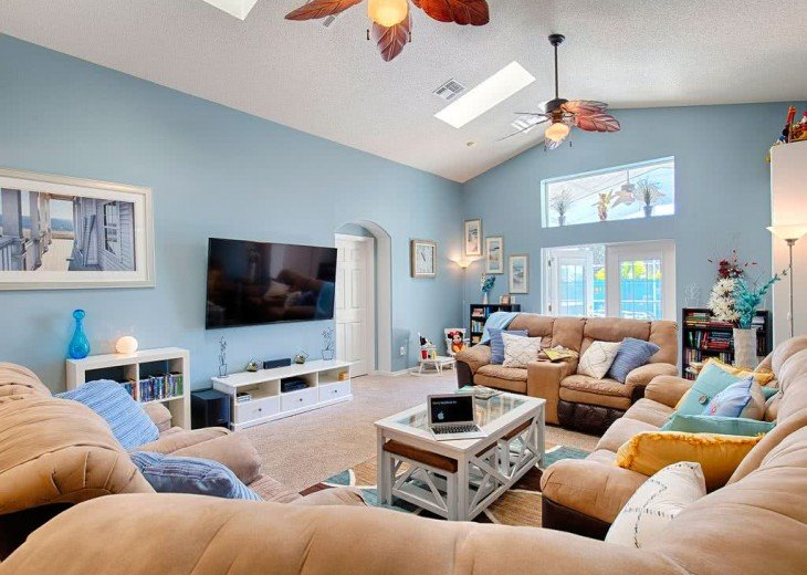 Spacious living area with 70 inch TV, Upgraded Cable, Netflix and 300+ Dvds