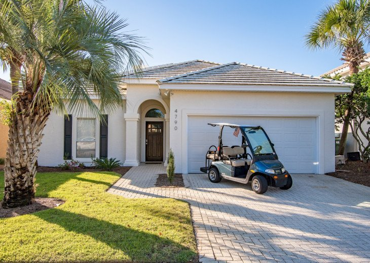 Front of home w/ private golf cart
