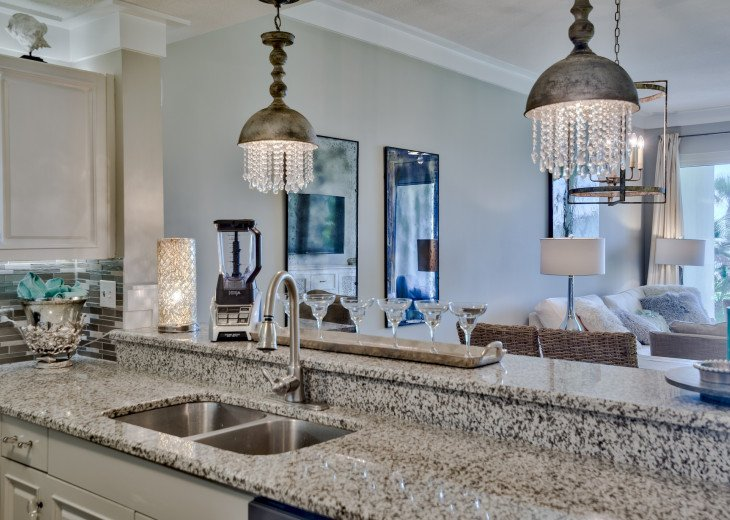Designer lighting and high-end furnishings! Luxury vacationing at the beach!