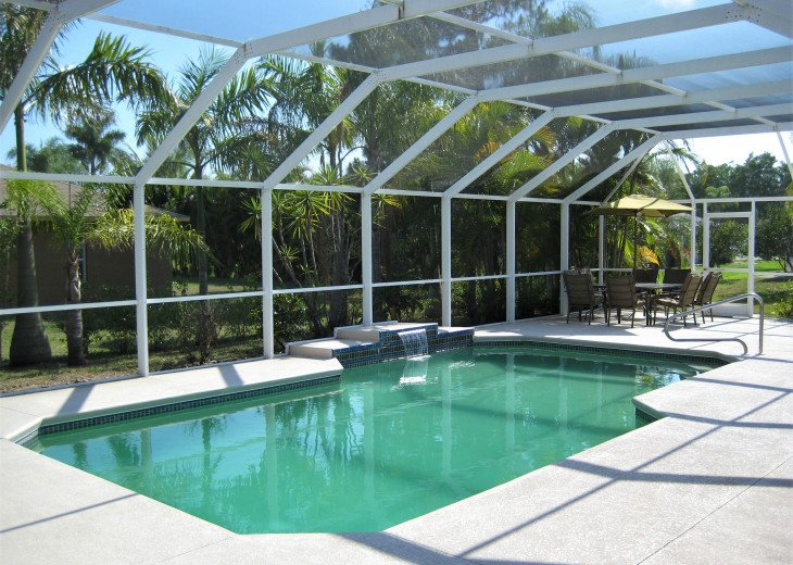 Enjoy the Florida sunshine! Large pool area to dine, entertain or just chill. #1