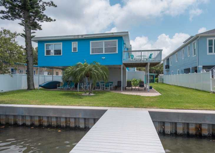 Large common area patio, yard and dock. Including BBQ, lounge chairs, tables