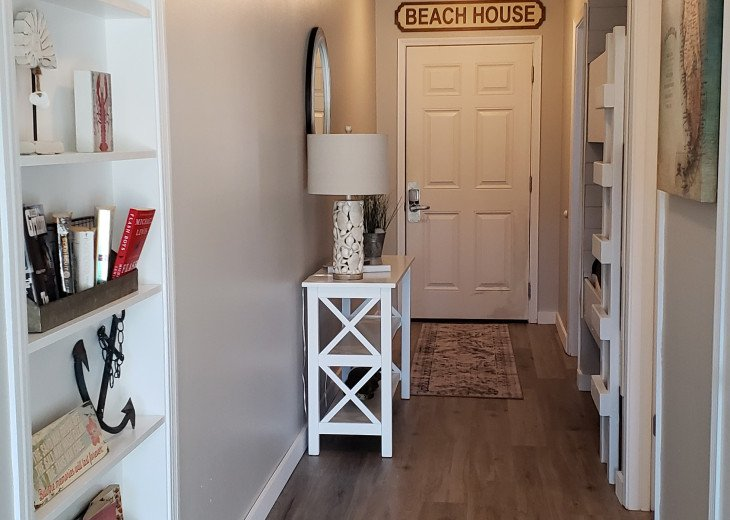 Welcoming entry, new paint, flooring and decor